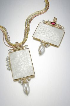 14k & Antique Chinese Gambling Chip Pendants. We carry the complete collection of jewelry designer Donna Chambers hand made antique mother-of-pearl gaming chip jewelry. Each one-of-a-kind piece of jewelry is perfect for those that want to wear the extraordinary! Visit Renaissance Fine Jewelry in Vermont. www.vermontjewel.com