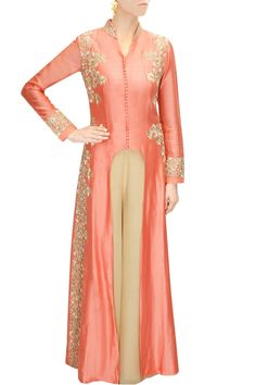 This peach colour kurta set features in a shell pink U cut in chanderi with floral zari, tikki, resham and cutdana embroidery. This peach colour kurta set comes