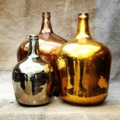metallic gold, silver, and copper glass bottles