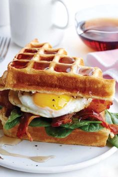 Buttermilk Waffle, Bacon and Egg Sandwich: Why choose when you can have waffles and eggs?! This is the perfect brunch sandwich. Click through to discover more quick and easy brunch recipes perfect for Mother's Day.