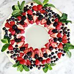 This Fruit Pizza Christmas Wreath is ontheblog Its was gone within minutes at our house Our family fruit pizza but I had a fun idea on how to make it into a Christmas wreath And wouldnt you know our little trick worked out beautifully So delicious easy so festive christmas creativefood christmaswreath christmasfood dessert cookies pizza