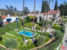 Location: Ellen's new listing, which is a spacious 2,456 square feet, will likely not be a difficult sell, as it sits perfectly on top of a street level single car garage - surrounded by a small fruit orchard and olive trees