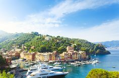 Portofino This photogenic fishing village is known for its historic charm, candy-colored houses, and panoramic views of the Ligurian Sea. It's also home to luxury resorts and high-end shopping.