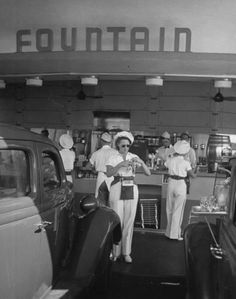 Carhops busy with orders at a drive-in soda fountain in Los Angeles, 1938. Description from pinterest.com. I searched for this on bing.com/images