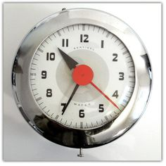 """The """"Sentinel Wafer"""" electric wall clock - The Ingraham Co. - 1940's - designer Henry Dreyfuss."""