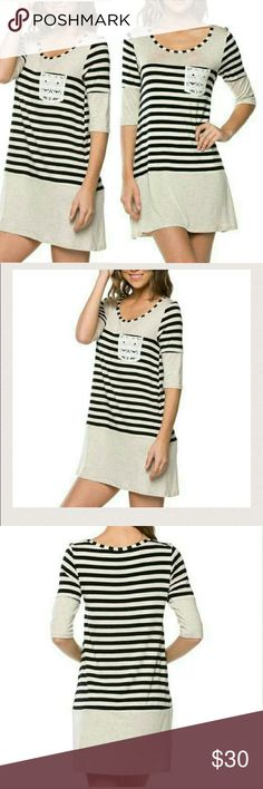 STRIPED SHIFT DRESS WITH LACE POCKET New oat color dress with black stripes & lace pocket. Can be worn as a dress or with leggings.  95% Rayon/5% Spandex Available in S,M,L Length approximately 34 inches BUST SIZE S-33.5-35, M- 36-38, L 38-40 Made in USA PRICE IS FIRM 4 Bidden Boutique  Dresses Mini