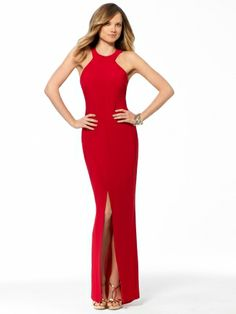 Embody siren appeal in this fiery gown flaunting a strappy back and a thigh-high slit. Round Neck HalterStrappy Back.LinedBack ZipHook and EyeHigh front Slit58 inch Body Length95% Polyester 5% SpandexLining:95% polyester 5% spandexMade In USAMachine Wash Cold