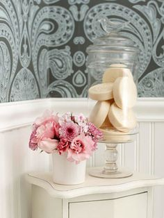 Small Bathroom Remodels on a Budget. I kind of like the idea of putting soap in a glass jar. Might be fun with a couple different colors...