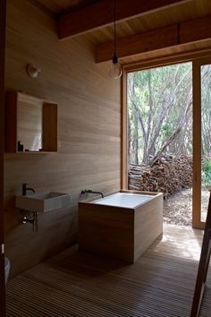 10 Ideas For Designing With a Modern Bathtub - Photo 6 of 10 - Houle designed the ofuro tub in the master bath to mesh with the home's tallowwood wall paneling. The Ikea sink is outfitted with Vola faucets.