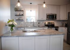 Kitchen renovation by Lemon Thistle. I like how much functionality she packed in here without extravagance. It's simple and classy.