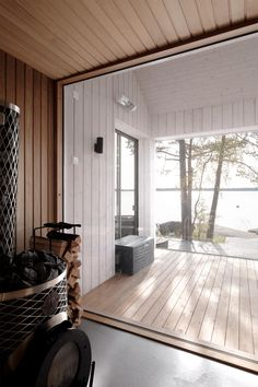 Sauna located in the archipelago of Turku, Finland. The building blends perfectly into the surrounding terrain. Interior Architecture, Interior And Exterior, Lakeside Cottage, Chalet Style, Wooden Cabins, House Layouts, Log Homes, Home Deco, Home And Living