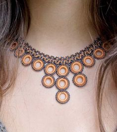 Our most Chic & Unique Collection of Hand Crocheted Jewelry The Apricot Chic Crochet Necklace has a natural tone to blend with any skin tone, and the navy blue beads make it pop. Stunning colors & del