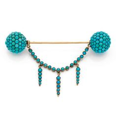 A turquoise and gold brooch circa 1860.