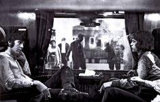 Paul McCartney and Mick Jagger on a train to Bangor. (1967)
