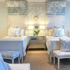 Love the mirrored table between the beds.