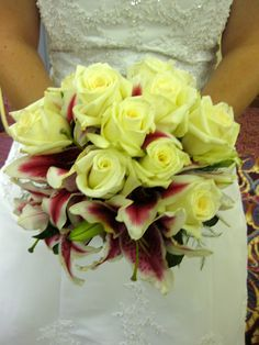 White roses and stargazers with striking contrast
