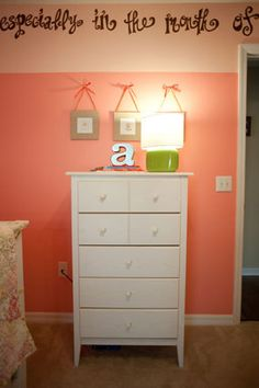 peach coral baby girl nursery for Autumn collage of flower art over dresser