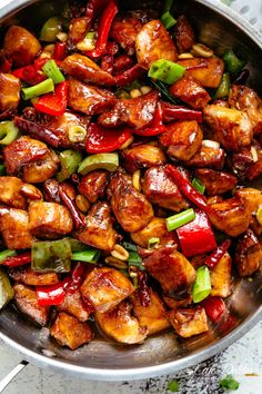 Kung Pao Chickenis highly addictive stir-fried chicken with the perfect combination of salty, sweet and spicy flavour! Make it better than Chinese take out right at home! With crisp-tender chicken pieces and some crunchy veggies thrown in, this is one Kung Pao chicken recipe hard to pass up! | cafedelites.com