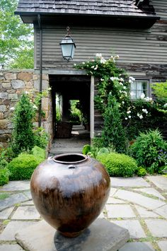 Olive jar in An Architect's Garden. By Tendenze Design. Via Little Red House.