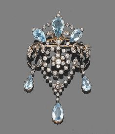 A belle epoque aquamarine and diamond brooch/pendant, circa 1910  The openwork cartouche set with rose-cut diamonds and pear-shaped aquamarines, suspending a cicular millegrain-set old brilliant-cut diamond swag centre and terminating in three collet-set rose-cut diamond and pear-shaped aquamarine drops, mounted in silver and gold, diamonds approx. 0.70ct. total, length 6.0cm.