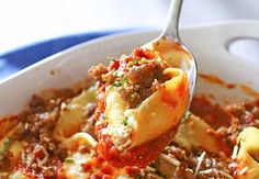 Stuffed Shells: I used 1 24-oz jar of Franco Rinaldi Tomato & Basil Spaghetti Sauce for the marinara in the recipe.  I had a few leftover shells after using all the stuffing, so I just tucked them between the stuffed shells.
