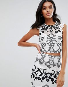 Buy it now. Lipsy Cropped Printed Top - White. Top by Lipsy, Lined mesh, Lace overlays, Crew neck, Cap sleeves, Keyhole back, Cropped length, Slim fit - cut close to the body, Machine wash, 89% Polyester, 11% Polyamide, Our model wears a UK 8/EU 36/US 4 and is 173cm/5'8 tall. ABOUT LIPSY Renowned for their statement party dresses, London fashion brand Lipsy channel a young, fun vibe in their partywear, footwear and jewellery collections. Dedicated to delivering fashion forward styles; look…