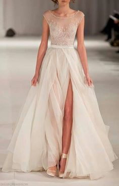 Sheer bodice #wedding #gown ♥ For bridal gown options ... https://itunes.apple.com/us/app/the-gold-wedding-planner/id498112599?ls=1=8 ♥ For more wedding inspiration ... http://pinterest.com/groomsandbrides/boards/