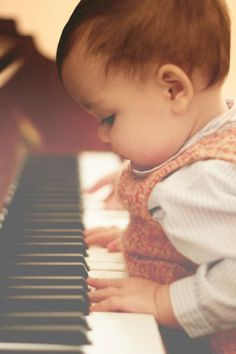 Learning to play piano at a young age.