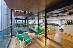 AECOM, Sydney by BVN. Image: John Gollings. Informal meeting areas jut out into the peripheral void above the stair.
