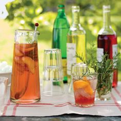 Peach and Rosemary Spritzers via Delish