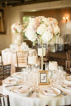 Tall centerpieces filled with hydrangeas, roses and greenery are so chic! {@melvingilbert}
