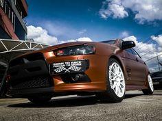 """No 7º episódio da serie Samy compartilha toda a sua experiencia  conosco em um incrível projeto executado com excelência em seu próprio carro, um Mitsubishi Lancer todo equipado para as pistas. Os detalhes do projeto e os conceitos deste """"MONSTRO"""" do envelopamento você confere agora no IMPRIMAX GARAGE. Mitsubishi Lancer, Garage, Bmw, Vehicles, Cars, Carport Garage, Garages, Car, Car Garage"""