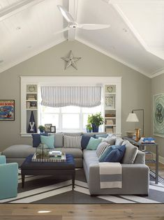 "Latest Coastal Living ShowhouseI am loving the transitional color palette of this room.  Paint Color:  ""Pratt & Lambert 2297 Windham"". The upholstered furniture is by Lee Industries."