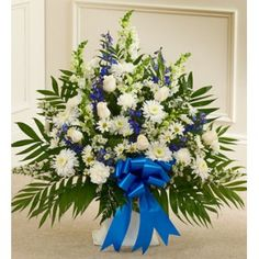Whites and Blues Arrangement PZ408-07     ProFuneralFlowers.com  Head Office:  International Phone Number: +1 416-356-7478  60 Doncaster Ave Unit #6  Thornhill, ON, Canada