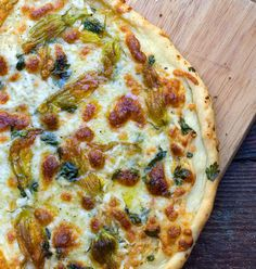 Squash Blossom Pizza.  The season is almost here for these blossoms.
