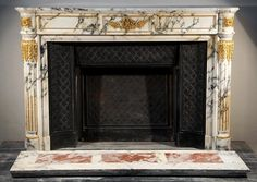 Very beautiful antique Louis XVI style fireplace made out of Panazeau marble and gilded bronze with half columns (Reference 2468) - - Available at Galerie Marc Maison #fireplace #antique #19thcentury #paonazzo #marble #saintouen #fleamarket