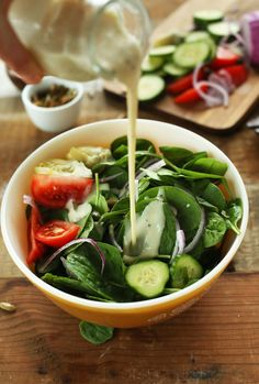 AMAZING Spinach Salad loaded with veggies and dressed in a simple, creamy #VEGAN dressing!