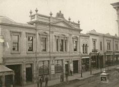 Theatre Royal, Hindley Street (north side), Adelaide, 1881 - The billboard in front of the theatre advertises George Musgrove's production of Offenbach's 'La Fille du Tambour Major', starring Nellie Stewart. This production toured Australia in the early 1800s. On the right is the ornate lamp belonging to the White Hart Hotel opposite. The near side of Miller Anderson's (second store from the right) is 41 yards west of Gresham St. The extreme left of the photograph is 2 yards east of Peel St. City Of Adelaide, Research Images, Main Entrance, Tambour, South Australia, Capital City, Vintage Photographs, Victorian Era, Old Photos