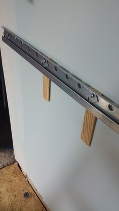 IKEA install tips, tools - Shims behind the rail in my not-even-a-little-bit flat wall
