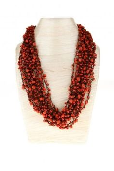 Red Coral Necklace - i saw one of these in a little store i went into about 4 years ago and have regretted not buying them ever since.