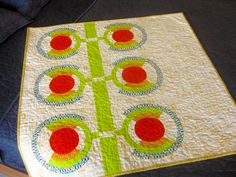 Jill Collins has an unusual quilt making advantage in that she has a laser cutter for making acrylic templates in her basement! She used it to make the templates for this beautiful quilt, featuring...
