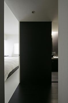 Cool Black And White Monochromatic Apartment Design : Cool Black And White Monochromatic Apartment Design With Wooden Bedroom Door And Bed Pillow Blanket Nightstand Big Window And Bathroom Wash Basin Lamp Mirror