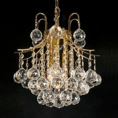 Grand, palatial style is resized for your home in this elegant crystal mini chandelier. Sparkling globes of cut crystal and a timeless gold finish reflect the glow from three 40-watt candelabra-base bulbs (not included) for a positively regal look.