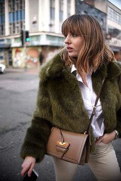 That green fur coat is so lush