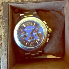 Michael Kors Watch Michael Kors watch. Excellent condition.  Midnight blue violet dial with gold and silver. Comes in original box and instructional handbook. Battery in working condition :) Michael Kors Other