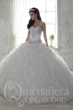 Be simply stunning in this shining ball gown with refined beadwork on the  bodice and a ec0b518023d2