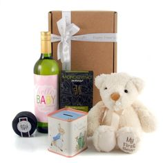 """A Beautiful New Baby Gift Set...for both the new baby girl and the new proud parents. Included is baby's first teddy bear he's super soft and cuddly with the softest cutest brown nose. For the new parents we've designed and printed labelling for the wine bottle. You can personalise the wine label with the baby boy's name and his birth date. The wording """"Hello Baby"""" is fixed so can't be changed."""