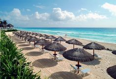 Relax by the ocean with your partner under your own private umbrella at Paradisus #Cancun