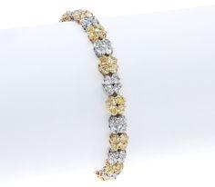 Gordon James Heart Cut Fancy Intense Yellow and White Diamond Bracelet. 21.56 carat total weight. Set in 18k yellow gold and platinum. http://www.gordonjamesdiamonds.com/products/diamond-bracelets/b-2074