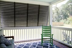 I went on the hunt to find Bahama shutters that fit the bill. Have you ever priced Bahama shutters? These shutters needed to be 70 inches tall and span a gap of 141 inches wide which meant custom shutters and that bill came to Farmhouse Shutters, Rustic Shutters, Outdoor Shutters, Diy Shutters, Louvered Shutters, Modern Farmhouse Exterior, Diy Exterior, Repurposed Shutters, Metal Roof Houses
